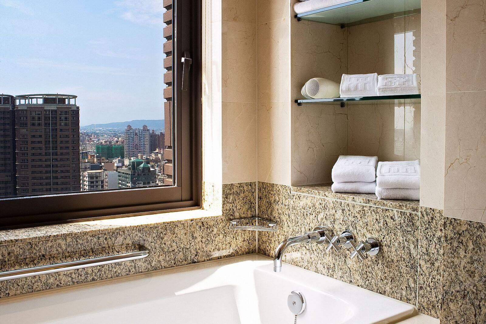 Ambassador Hotel Hsinchu Corner King Room features bathroom with a view
